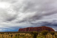 Wet Uluru (dawolf-) Tags: red nature wet rain rock clouds landscape sandstone nt australia uluru kata tjuta northern ayers olgas territory