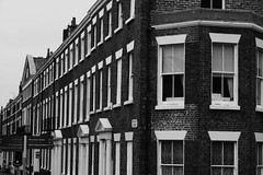 IMG_9039 (livvyrosedorothy) Tags: uk houses windows england blackandwhite white black reflection building sign wall architecture liverpool grey bricks line