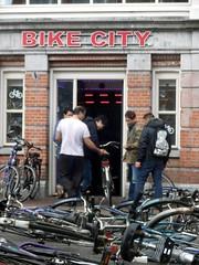 Messed Up Bikes (01) (Quetzalcoatl002) Tags: storm amsterdam mess wind bikes waterlooplein bikeshop messedup bikecity