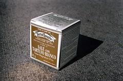 White Truffle Salt (jjldickinson) Tags: olympusom1 fujicolorsuperiaxtra400 roll497o2 promastermcautozoommacro2870mmf2842 promasterspectrum772mmuv italian food packaging concrete tartuflanghe salecontartufobianco tubermagnatumpico salt saltwithwhitetruffle whitetrufflesalt truffle whitetruffle seasoning fungus box shadow longbeach