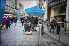 Street Salat (*monz*) Tags: street man streets birmingham nikon df sitting pavement candid muslim prayer banner mat isolation 24mm nikkor salat f28 bollard shoppers brum waterstones dawa namaz afd supplication jalsa monz nikondf24mmf28 qadac