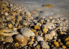 Pebble Sunrise. (hemlockwood1) Tags: sea water wales coast carmarthenshire rocks smooth pebbles shore pendine