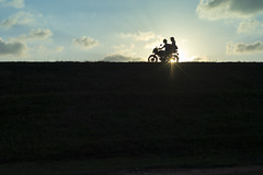 Ride into the sunset (Photosightfaces) Tags: sun wheel silhouette couple ride sri lanka motorbike riding motorcycle galle srilankan lankan asrilanka