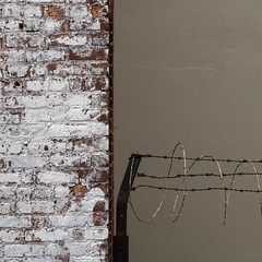 New York Architecture #279 (Ximo Michavila) Tags: nyc urban usa newyork abstract metal wall architecture square wire bricks 11 minimal barbedwire concept protection buiding archidose archdaily archiref ximomichavila