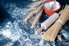 Pasta spaghetti with flour (lyule4ik) Tags: wood old food white love kitchen sign yellow horizontal vintage ties recipe pepper cuisine mixed italian raw heart background board traditional small egg wide salt cook tie spoon pasta delicious health spices cutting noodles variety copyspace spaghetti flour arrangement macaroni rolling spatula penne tagliatelle yolk nutrition rigatoni cloves farfalle unboiled