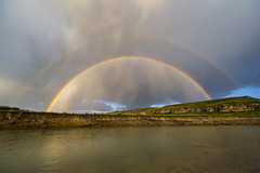 Sunset Double Rainbow over the Milk River, Writing-on-Stone Provincial Park, Alberta, Canada (Paul B Jones) Tags: sunset sky canada water rain clouds river landscape evening photo rainbow image picture twin wideangle photograph alberta doublerainbow sunshower arcenciel milkriver cutbank writingonstoneprovincialpark canoneos1dx ef1124mmf4lusm