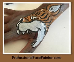 Tiger face painting (hand) art (professionalfacepainter) Tags: birthday party silly animal animals kids children fun facepainting kid hands artist child events tiger fingers parties event entertainment socal artists painter tigers bite thumb birthdays orangecounty facepaint celebrate southcounty professionalfacepainting