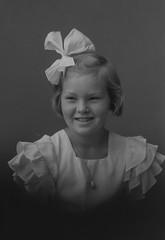PEM-CHA-N01413 Portrett av jente (Perspektivet Museum) Tags: portrait blackandwhite girl monochrome barn child dress jewellery ribbon pike jente portrett svarthvitt smykke kjole perspektivetmuseum slyfe chrhansen studioportrett flstadsamlingen