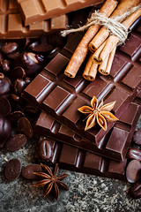 Delicious chocolates and spices on a dark background. (azimavu) Tags: chocolate sweet sweets dessert background food candy delicious brown cocoa dark gourmet closeup white tasty eat praline assortment snack chocolates gift sugar macro black cream bonbon bar milk cinnamon bitter ingredient calorie confectionery wooden cacao fat truffle