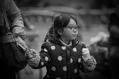 ADF_20140301_0559-2 (chiyowolf) Tags: chengdu sichuanprovince canoneos7d china streetscenes facesofchengdu peopleofchengdu portrait younggirl ponytail icecream holdinghands polkadots downjacket winterwear ef70200mmf28lisiiusm 中国 travelphotography 成都 四川