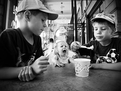 Icecream III (B-Lichter) Tags: street bw monochrome childhood pen children blackwhite twins wideangle olympus siblings explore icecream lugano zuiko explored epl3 wconpo1