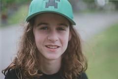 Isaac (Ali Seglins) Tags: boy summer portrait toronto film smile hat analog hair happy kid long brother cemetary sunny dude cap fujifilm bro canona1 minecraft aliseglins