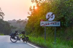 Plus tard (jbdodane) Tags: africa bicycle day410 gabon plustard road sign village freewheelycom cycling vlo cycletouring cyclotourisme velo jbcyclingafrica