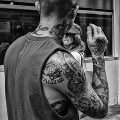 She Found Herself Strangely Attracted To The Tattoed Man (Culture Shlock) Tags: street people blackandwhite bw men tattoo women attract bodyart meet attraction tattos