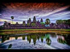 My Distorted View of Angkor Wat, Cambodia (Sam Antonio Photography) Tags: world old travel sunset sky cloud sun lake flower reflection building tree tower heritage tourism archaeology monument face up rock stone architecture facade sunrise landscape asian religious temple site ancient cambodia vishnu khmer exterior lotus buddha tomb ruin buddhism angkorwat structure palm unesco monsoon reap sacred tropical thom ba wisdom angkor wat yon hinduism ta vacations obsolete bayon raider canoneos5dmarkii cambodianculture canon1740lens samantoniophotography southeastasiaphotography photographingangkorwat