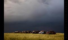 Huddled (Whitney Lake) Tags: storm cars rust colorado decay junkyard prairie kaiserfrazer