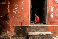 My name is RED (color patterns # 4) (alan0410photography) Tags: street door old boy red india house texture stairs canon kid sitting child sad candid indian canon600d