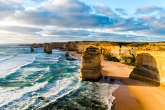 Sunset at the 12 Apostles - Australia (oncearoundtheworld) Tags: ocean road park lighting blue light sunset summer orange cliff sun green beach rock clouds coast nationalpark waves walk great pillar australia victoria national column 12 greatoceanroad twelve apostles greatoceanwalk