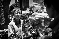 framing the truth~ Yunnan (~mimo~) Tags: china boy portrait people blackandwhite man blur reflection photography mirror asia streetphotography documentary frame yunnan ethnicminority mimokhairphotography