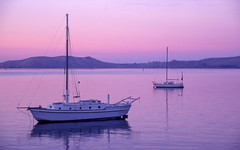Pastels (zebedee1971) Tags: sunset sea water harbour yacht dusk hill calm peninsula