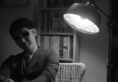 pluto (troutfactory) Tags: shadow portrait blackandwhite bw film lamp monochrome sunglasses japan cool friend availablelight rangefinder  osaka analogue kansai chiaroscuro ilforddelta400 lightandshadow   50mmnokton  voigtlanderbessat