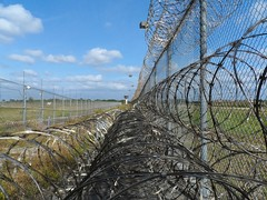 Prison Fence high security (JobsForFelonsHub) Tags: outside high wire security prison jail barb distance barbed maximum