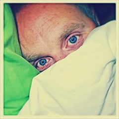 Look into my eyes...... (John D McKenna) Tags: blue gay bed eyes blueeyes bald stare uploaded:by=flickrmobile flickriosapp:filter=nofilter