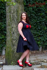 IMG_4495 (Neil Canon Keogh) Tags: red black vintage necklace highheels dress retro ring redhead bow buskers bracelet heels rockband pinup pinupgirl trianglesquare manchestercitycenter dressmodellaura