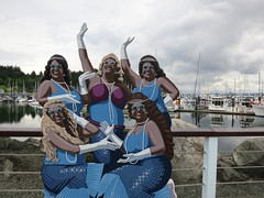 Anacortes divas (Ruth and Dave) Tags: blue art marina fence cutout costume mural waterfront harbour posing crossdressing transvestite glam mermaid fabulous anacortes waving diva glamorous
