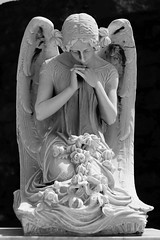 Angel of Mourning (JCent8) Tags: vacation blackandwhite holiday colors cemetery architecture angel canon death oldsanjuan headstone sanjuan centeno
