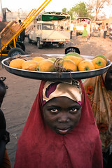 Mango? (Edward Morgan Photo) Tags: africa portrait people niger fruit children child market head places mango tray balance seller