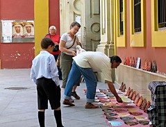 Catherine shopping for souvenirs, Seville (ali eminov) Tags: espaa shopping souvenirs sevilla spain seville catherine fans selling buying catherinerudin