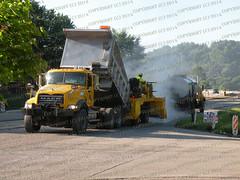Chip-spreader and Dump (cmastracci) Tags: dumptruck rubber tired roller chip roll asphalt tar penndot spreader tartruck liquidasphalt chipspreader