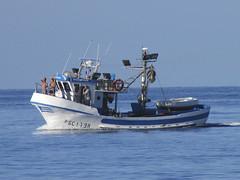 Nuestros barcos artesano con sede en Arguineguin en busca de la  faena diaria