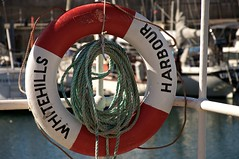 How To Save A Life (4oClock) Tags: life red orange white colour industry water marina work circle easter coast scotland spring fishing nikon aberdeenshire harbour traditional north scottish sunny save safety ring hills april safe scotch nikkor dslr lifebuoy buoy lifesaver lifering 18105 preserver grampian whitehills d90 banffshire lifebelf lifedonut