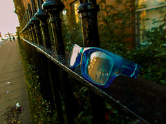 she lost her glasses (vfrgk) Tags: street windows sky people plants house black reflection green eye lost glasses pavement perspective streetphotography frame passing ironfence urbanphotography electricblue