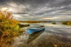 Dark side of lake (Nejdet Duzen) Tags: trip travel lake reflection turkey boat cloudy türkiye sandal göl yansıma turkei seyahat manisa kayık bulutlu gölmarmara
