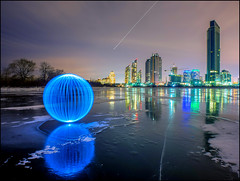 On Humber Ice (Rodrick Dale) Tags: winter sky lake toronto ontario canada lightpainting cold building ice skyline reflections bay orb humber