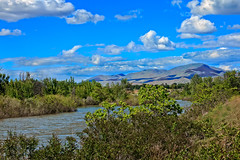 Butte View (http://fineartamerica.com/profiles/robert-bales.ht) Tags: blue foothills green water beautiful river spectacular spring awesome scenic surreal peaceful panoramic idaho sensational inspirational sublime refreshing magical emmett magnificent inspiring haybales payetteriver canonshooter treasurevalley gemcounty scenicbiway pacificnorthwestphotography squawbutte riverphotography idahophotography robertbales americaphotography northamericaphotography scenicriverphotography