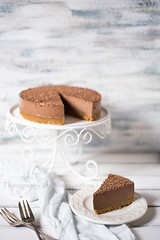 Chocolate cheesecake (vanilllaph) Tags: food brown white cake vertical cheese bar dark menu recipe table dessert cookbook flavor sweet cut eating chocolate tasty cheesecake celebration delicious eat homemade slice round taste copyspace piece simple celebrate preparation celebrating prepared