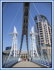 Salford Quays 7. jpg (Margaret Edge the bee girl) Tags: bridge blue windows light sky sun white lines architecture modern buildings manchester outdoors path salfordquays structure
