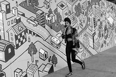 (feldmanrick) Tags: street blackandwhite bw woman monochrome berkeley mural fuji outdoor candid streetphotography sidewalk fujifilm unposed decisivemoment rickfeldman x100t