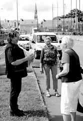 Postwoman and ladies (patrick_milan) Tags: street people blackandwhite bw woman white black girl monochrome lady noir post noiretblanc femme nb dame rue fille blanc personne streetview gens postman poswoman