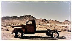 you got to love the backdrop...(HTT) (BillsExplorations) Tags: old mountains abandoned truck vintage gold rust ruins decay nevada mining forgotten ghosttown rhyolite htt abandonedtruck truckthursday