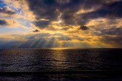 Let there be light.... (malc1702) Tags: sunrays clouds darkclouds rays nature sea ocean sky orangeglow scenic nikond7100 nikkor18140mm twop flickrunitedaward fantasticnature ngc