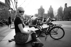 ([ raymond ]) Tags: nyc portrait woman sun sunlight newyork girl fashion bike bicycle socks hair washingtonsquarepark style skirt blonde connie asianamerican bangs img2479