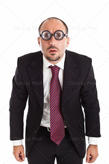 Poor Sight Businessman staring (Dario Lo Presti) Tags: people white male nerd businessman lens fun glasses bigeyes interesting funny humorous different geek unique humor young business suit whitebackground round confused staring perplexed thick isolated fool foureyes eyewear eyesight attire nearsight diopters pooreyesight aquula