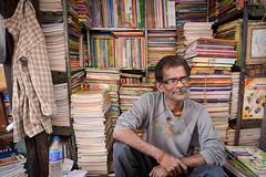 Book Seller (Leonid Plotkin) Tags: india man book asia bookstore bookshop kolkata bengal calcutta westbengal bookseller bookmarket