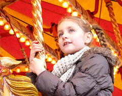 (Pam 73) Tags: leeds yorkshire carousel leedschristmasmarket horse girl portrait pole lights scarf plaits ride merrygoround