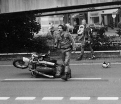 The next day at the Chaos Days in Hannover, 04.08.1984. A motorcyle cop being kicked-off his bike, with GDHC-Punx being involved. 1st photo (photographer unknown) shows the cop with his gun drawn at the